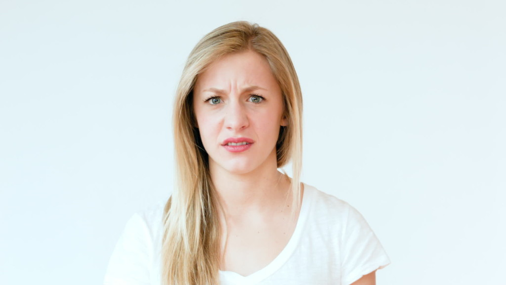stock-footage-girl-looks-grossed-out-or-disgusted-makes-funny-faces